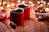 Valentines Day Coffee Cups Pair and Lighting Decorations on Retro Wood Background