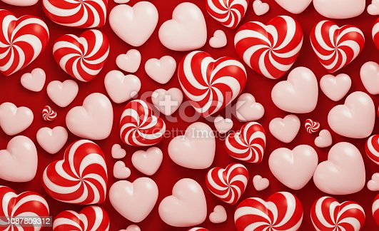 Candy like red and white heart shapes on red background. Horizontal composition with  copy space.