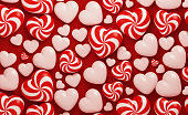 Valentine's Day Concept- Candy Like Red And White Heart Shapes On Red Background