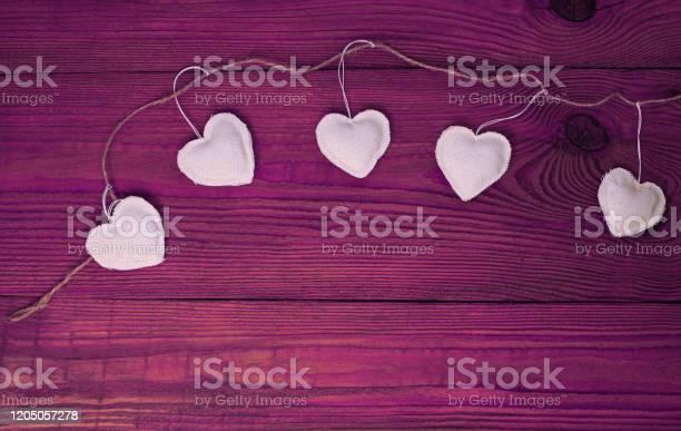 Valentines day concept design flat layeco linen hearts garland on picture id1205057278?b=1&k=6&m=1205057278&s=612x612&h=hqagtrpjmenvqa b6pxf3 ri3u4c maeomsiavxizpw=