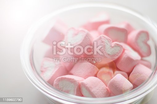 157527860 istock photo Valentines day concept. Heart shape of marshmallow in pink and white color in bowl. 1159602790
