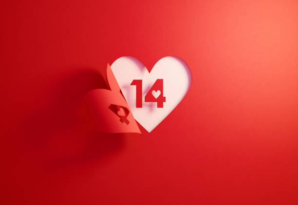 valentine's day concept- number 14 inside of a red folding heart shape on white background - kartka na walentynki zdjęcia i obrazy z banku zdjęć