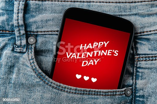 898149690 istock photo Valentine's day concept on smartphone screen in jeans pocket 906540592
