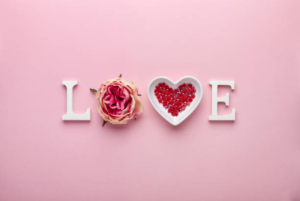 Valentine's day concept with love letters on pink background. stock photo