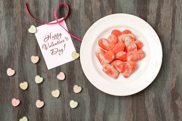 Valentine's Day Cookies and Candy With Love Note stock photo