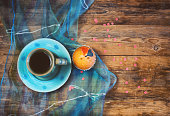 valentine's day, cup of coffee, sweet cake, silk cloth on a wooden table and confetti, retro style