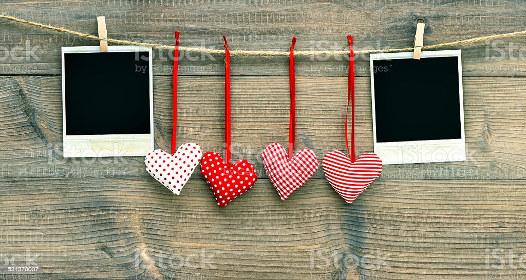 Valentines Day decoration. Red hearts and photo frame stock photo