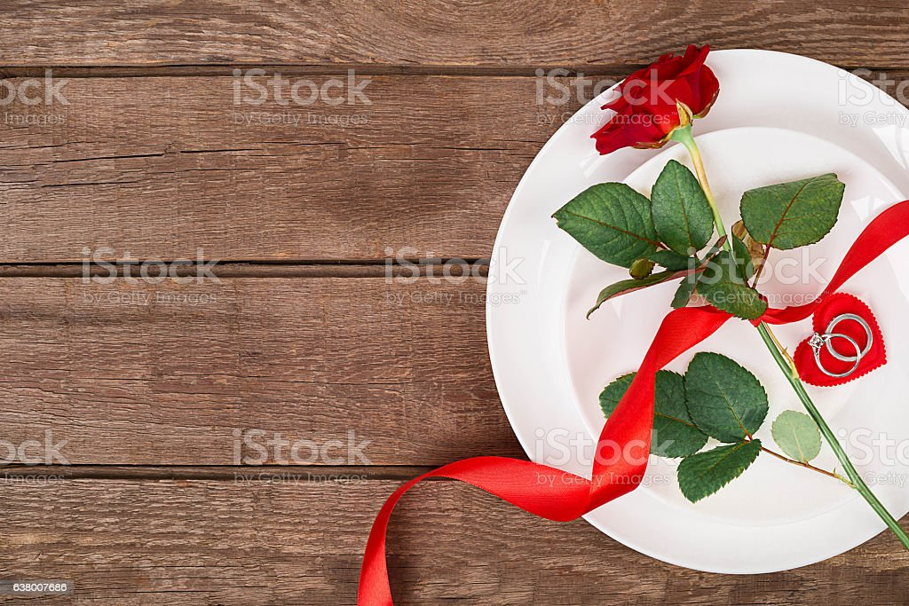 Valentines Day Dinner Table Setting With Red Ribbon Rose Stock Photo