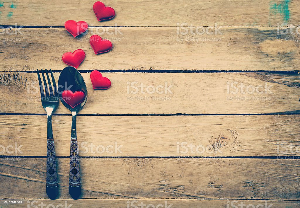 Valentines day dinner with table setting in rustic wood stock photo