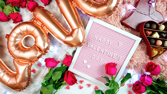 istock Valentine's Day flat lay with roses, chocolates and letterboard. 1199487489