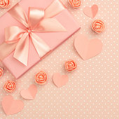 istock Valentines day flower composition on living coral background with coral flowers rose, paper small hearts, gift box flat lay. Mothers day, 8 March Women day. Top view 1133003225