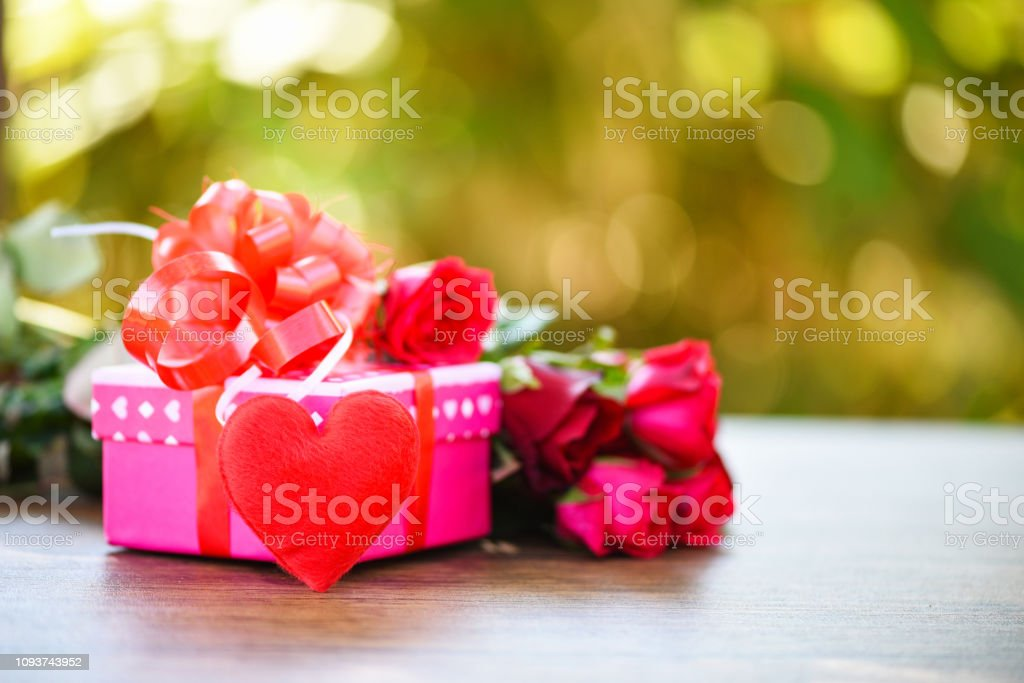Valentines day gift box flower love concept / Pink gift box with...