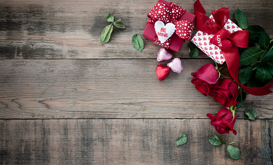Valentine's Day Gift with Chocolates and Roses on an Old Wood Background