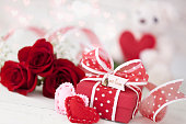 Valentine's Day Gift with Red Roses against a White Background