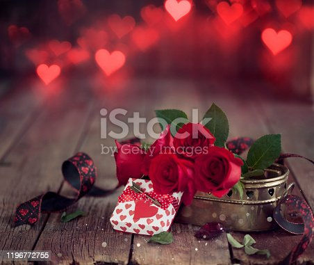 Valentine's Day Gift with Red Roses on a Dark Wood Background