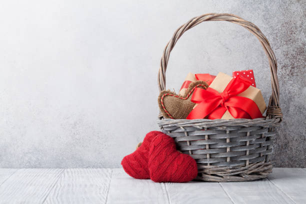 Valentine's day greeting card Valentine's day greeting card with gift boxes in basket. With space for your greetings basket stock pictures, royalty-free photos & images