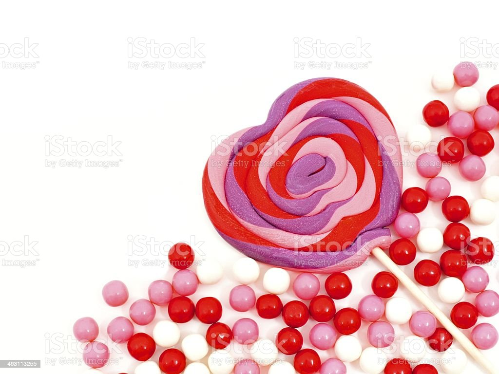 Valentines Day heart shaped lollipop and candy corner border stock photo