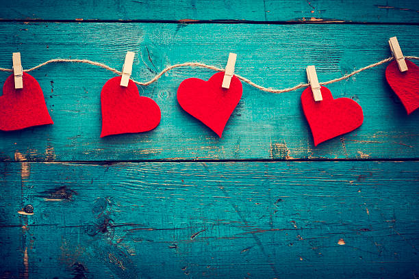 valentines day hearts on wooden background - love stock photos and pictures