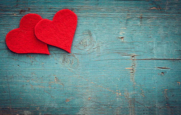 valentines day hearts on wooden background - february stock photos and pictures