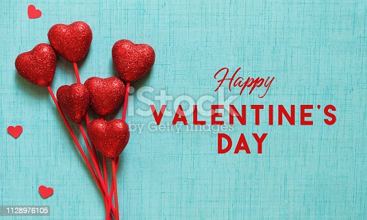 Romantic style banner with Happy valentines day text on blue texture background.