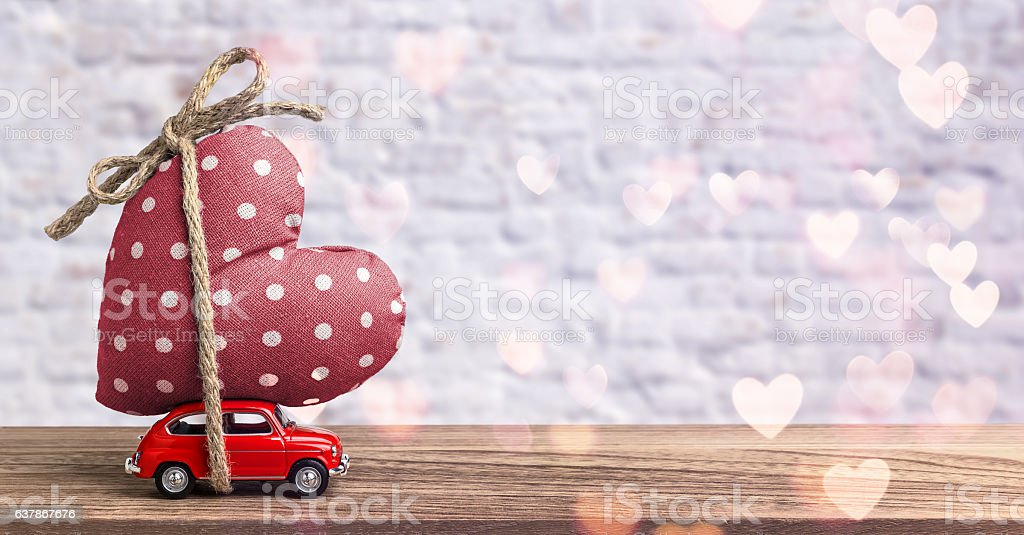 Valentines Day Incoming - Miniature Red Car Carrying Heart - Photo