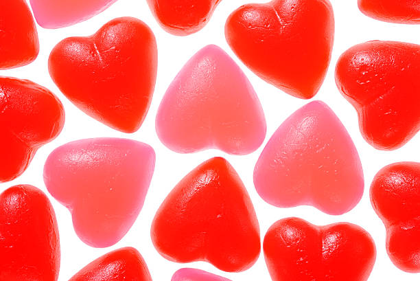 Valentine's day jujubes Valentine's day heart background made of red and pink jujubes candies jujube candy stock pictures, royalty-free photos & images