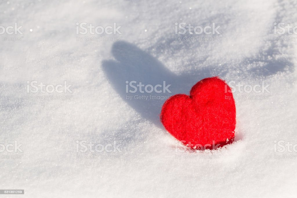 Valentines Day Love Heart In Snow With Shadow stock photo