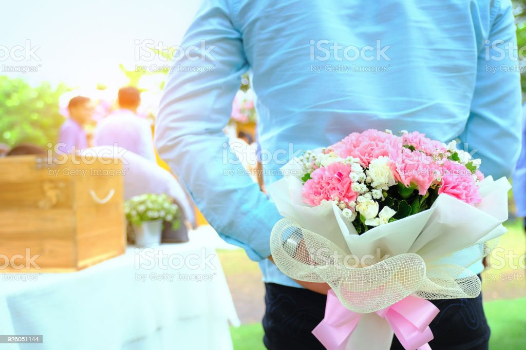 Valentines Day Man Hiding Behind A Bouquet Of Flowers Handsome Man ...