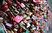 Valentine's Day - many padlocks on a bridge - red padlock with heart in the front