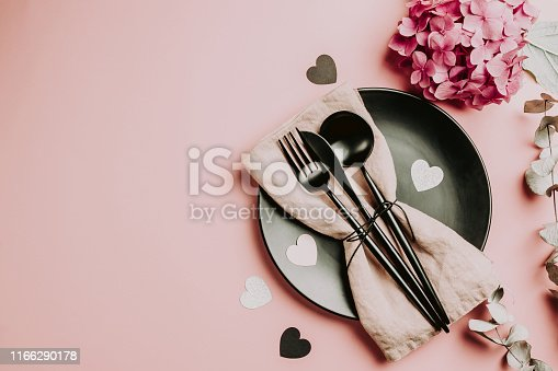 Valentines day or wedding meal background. Romantic holiday table setting. Black and pink table setting. Flat lay