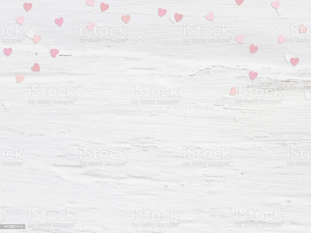 Valentines day or wedding mockup scene paper hearts confetti and empty space for text. Grunge white background, flat lay image. Top view stock photo