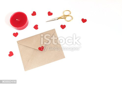 Valentines day or wedding mockup scene with envelope, paper hearts confetti, red candle, golden scissors on white background. Love concept. Flat lay, top view, empty space for your text.
