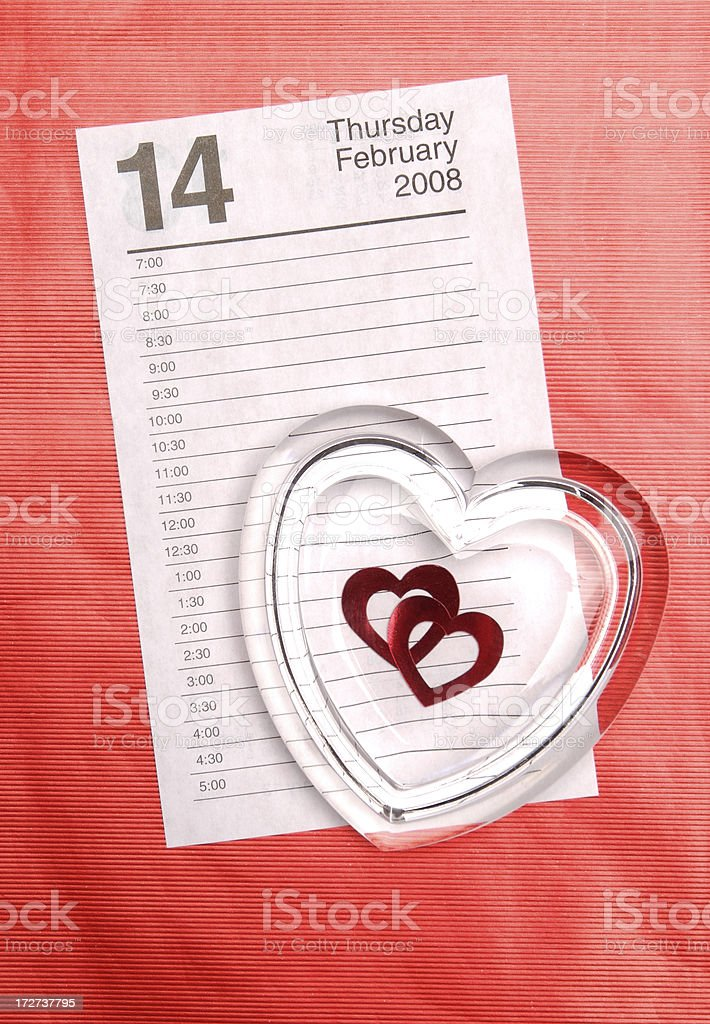 Valentine's Day Paperweight on Calendar royalty-free stock photo