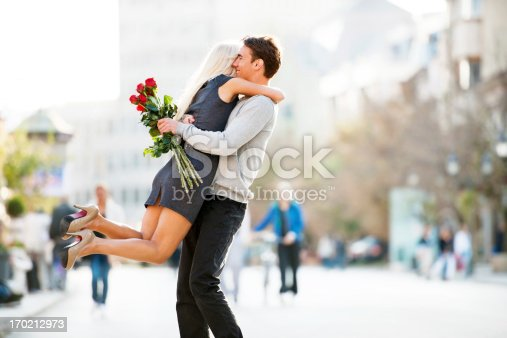 Young embracing couple.