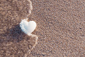 Heart shapes on a beach at Deerfield Beach Florida during the end of the day. Nobody in a picture. Concept for copy space. With or without water sea.