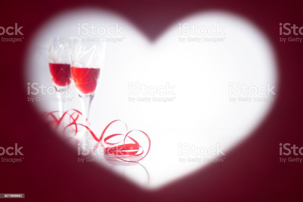 Valentine\'s Day. Picture in the form of heart. Two glasses with red...