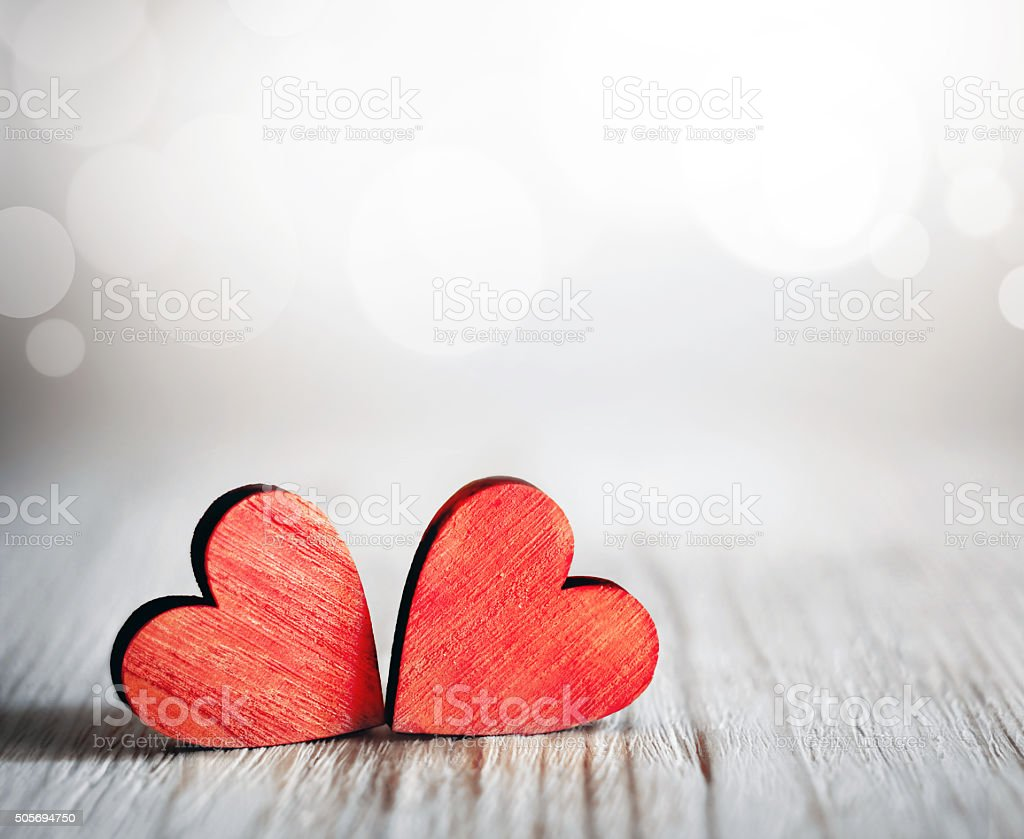 Valentines day. Red hearts on wooden background stock photo