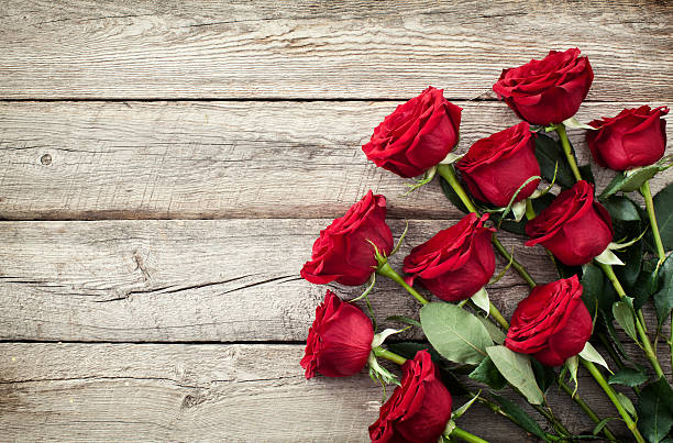 Valentines day red roses bouquet on old rustic wood background picture id503805944?b=1&k=6&m=503805944&s=612x612&w=0&h=optu9cvwgxxdh6eparfgjkq0srmmzy1h5ibvurqmary=