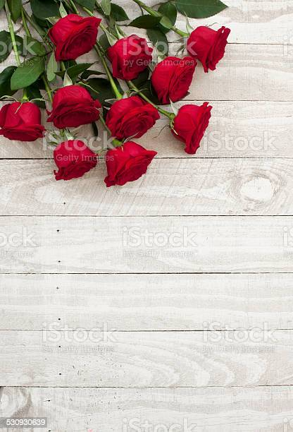 Valentines day red roses bouquet on old rustic wood table picture id530930639?b=1&k=6&m=530930639&s=612x612&h=ymf t e61k65qvbid73e4ghffuv06oqwm7axq456gc8=