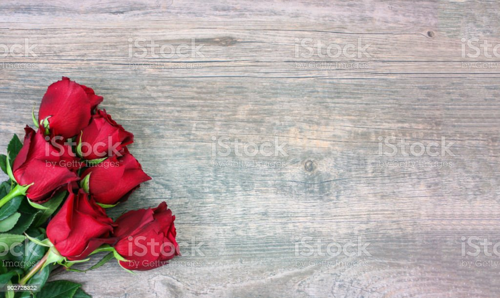 Valentine's Day Red Roses Over Wood Background