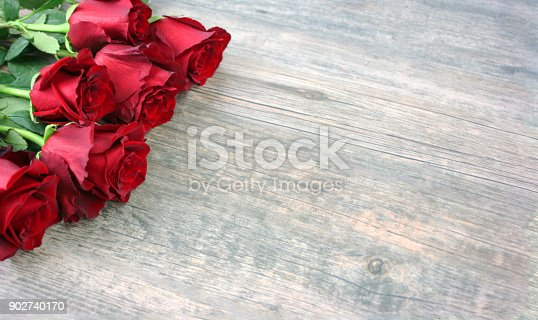 istock Valentine's Day Red Roses Over Wooden Background 902740170