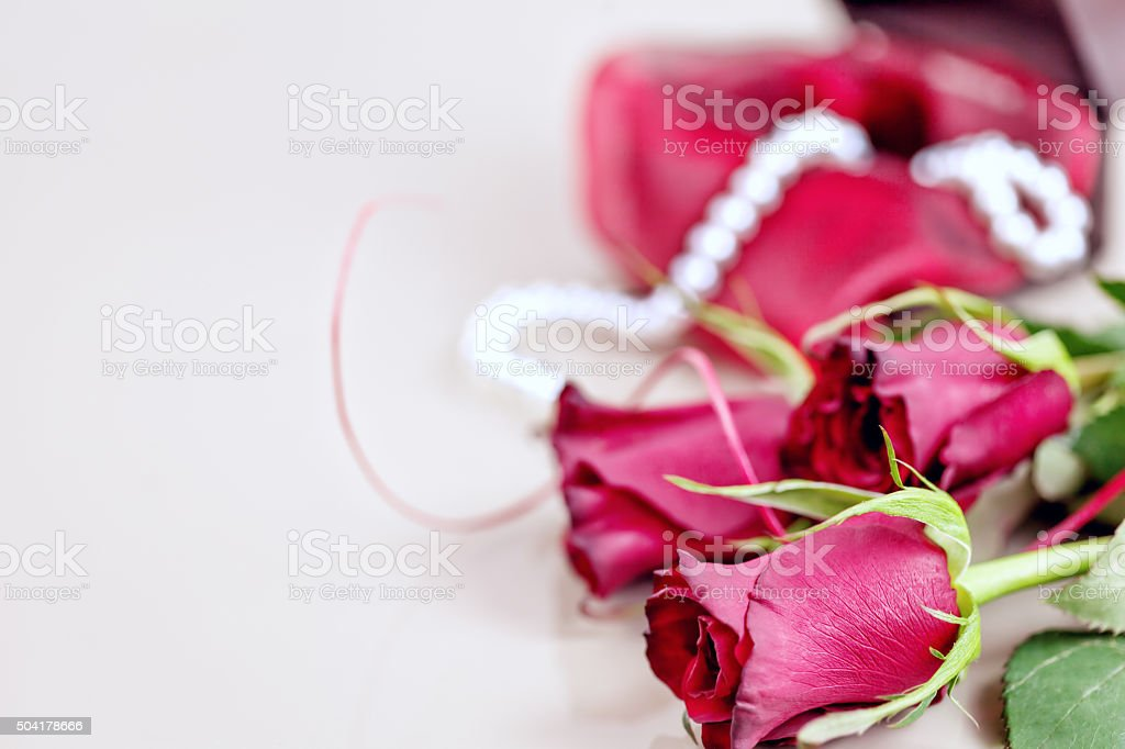 Valentine's day - red roses with white pearls stock photo