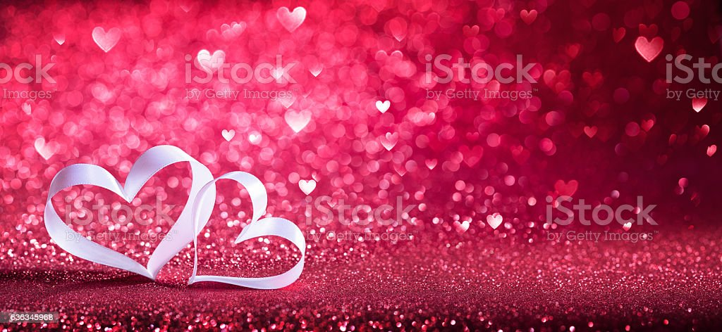 Valentines Day - Ribbon Shaped Hearts On Red Shiny Background stock photo