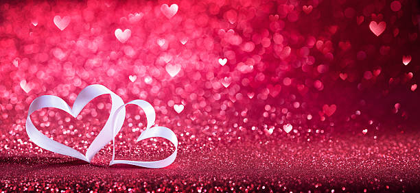 Valentines Day - Ribbon Shaped Hearts On Red Shiny Background - Photo