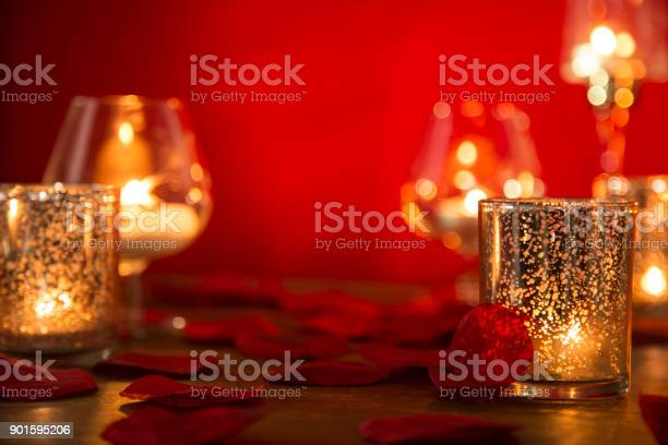Valentines day romance with candles and rose petals picture id901595206?b=1&k=6&m=901595206&s=612x612&h=wfdd9acwexookhujkbdjue6xrr i  5krr3xrjocotg=