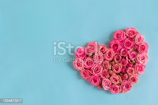 507397624 istock photo Valentine's day romantic greeting card. Composition with a heart of pink roses on a blue background.Mothers day. 8 Marth. Banner for advertising store, website, posters, advertising, coupons. 1204872017