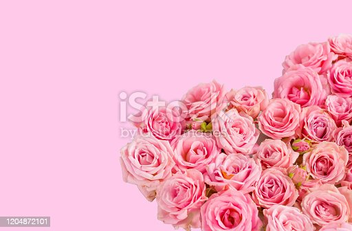 507397624 istock photo Valentine's day romantic greeting card. Composition with a heart of pink roses on a pink background.Mothers day. 8 Marth. Banner for advertising store, website, posters, advertising, coupons. 1204872101