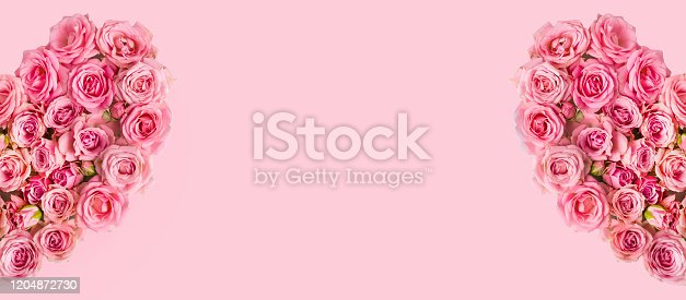 507397624 istock photo Valentine's day romantic greeting card. Composition with a heart of pink roses on a pink background.Mothers day. 8 Marth. Banner for advertising store, website, posters, advertising, coupons. 1204872730