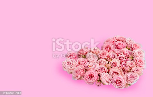 507397624 istock photo Valentine's day romantic greeting card. Composition with a heart of pink roses on a pink background.Mothers day. 8 Marth. Banner for advertising store, website, posters, advertising, coupons. 1204872799