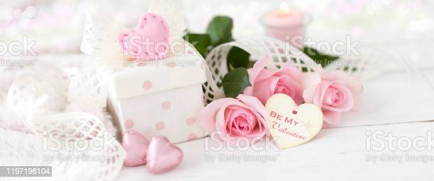 Valentines day roses and a gift on an old wood background picture id1197198104?b=1&k=6&m=1197198104&s=612x612&h=wg6sxrgymvs 7qmjnukumm1i72cgkyynq8kl qiae2s=